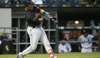 Cleveland Indians' Jose Ramirez singles off Chicago White Sox starting pitcher Derek Holland during the fourth inning of a baseball game Friday, July 28, 2017, in Chicago. (AP Photo/Charles Rex Arbogast)