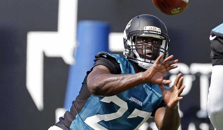 Jacksonville Jaguars running back Leonard Fournette (27) catches a pass during NFL football training camp, Friday, July 28, 2017, in Jacksonville, Fla. (AP Photo/John Raoux)