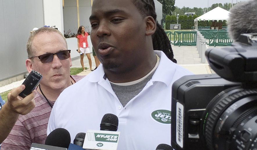 New York Jets nose tackle Steve McLendon speak with reporters at NFL football training camp Friday, July 28, 2017, in Florham Park, N.J. (AP Photo/Dennis Waszak)