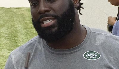 New York Jets linebacker Demario Davis speak with reporters at NFL football training camp Friday, July 28, 2017, in Florham Park, N.J. (AP Photo/Dennis Waszak)