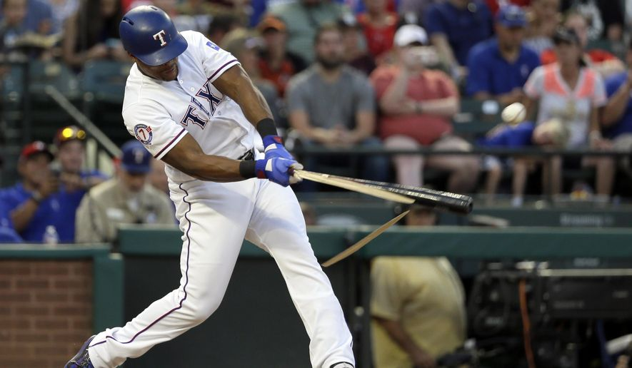 Texas Rangers' Adrian Beltre breaks his bat hitting a run-scoring single off a pitch from Baltimore Orioles' Chris Tillman in the third inning of a baseball game, Friday, July 28, 2017, in Arlington, Texas. It was Beltre's 2,997th career hit and scored Nomar Mazara. (AP Photo/Tony Gutierrez)