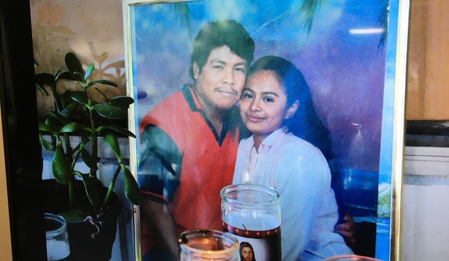 This photo of Ismael Lopez, left, and his wife Claudia, was shown to reporters during a news conference on Friday, July 28, 2017, in Memphis, Tenn. Authorities say Lopez was shot by police in Southaven, Miss. (AP Photo/Adrian Sainz).
