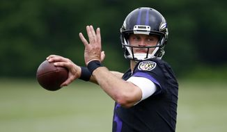Baltimore Ravens quarterback Ryan Mallett runs a drill during an NFL football training camp practice in Owings Mills, Md., Friday, July 28, 2017. (AP Photo/Patrick Semansky)