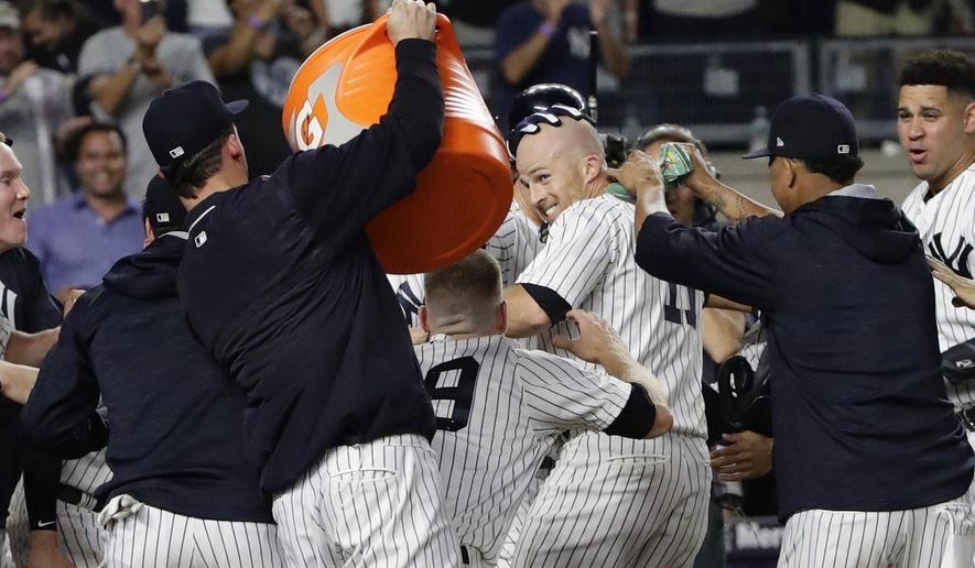 New York Yankees' Brett Gardner, center, celebrates with teammates after hitting a walk-off home run during the 11th inning of the team's baseball game against the Tampa Bay Rays on Thursday, July 27, 2017, in New York. The Yankees won 6-5. (AP Photo/Frank Franklin II)