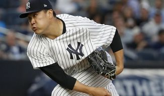 New York Yankees starting pitcher Masahiro Tanaka watches a pitch to the Tampa Bay Rays during the fourth inning of a baseball game, Friday, July 28, 2017, in New York. (AP Photo/Julie Jacobson)