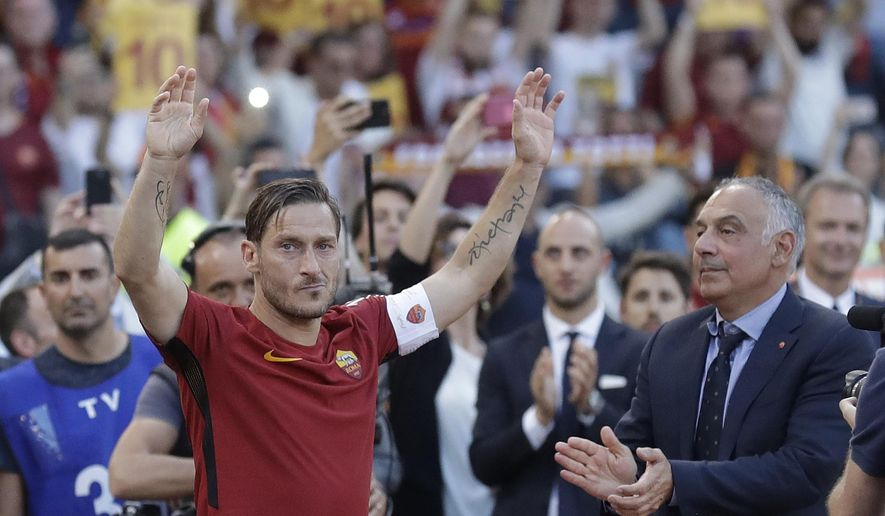 FILE -- In this Sunday, May 28, 2017 photo made available Thursday  July 27, 2017 Roma President James Pallotta, right, applauds as Francesco Totti salutes his fans after an Italian Serie A soccer match between Roma and Genoa at the Olympic stadium in Rome. The American president of the Roma soccer club is running out of patience. If regional authorities don't approve construction of a long-delayed new stadium for the team, Boston executive James Pallotta is prepared to sell the team. (AP Photo/Alessandra Tarantino)