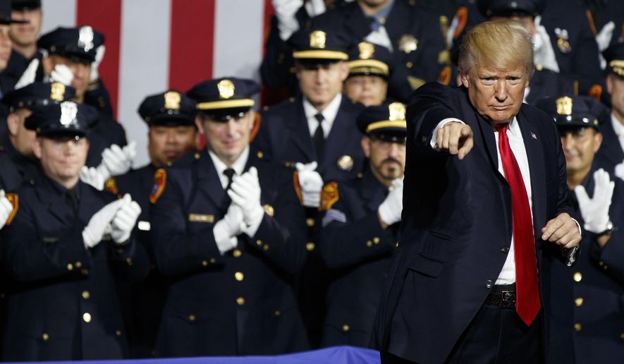 President Donald Trump points to the crowd after speaking to law enforcement officials on the street gang MS-13, Friday, July 28, 2017, in Brentwood, N.Y. (AP Photo/Evan Vucci)
