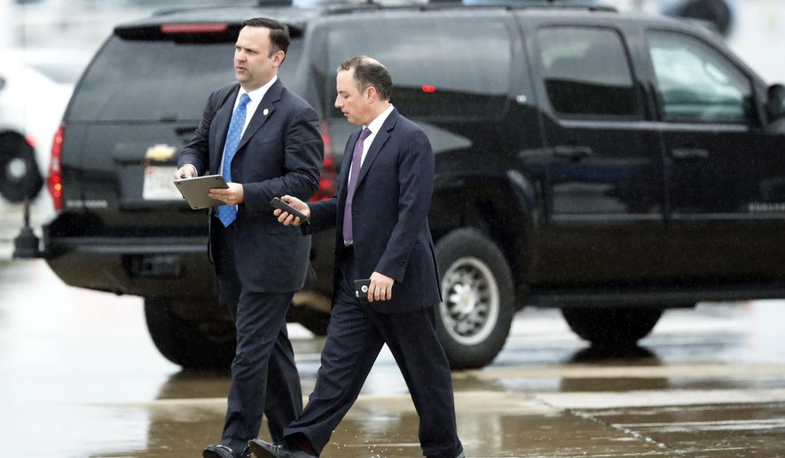 White House Director of Social Media Dan Scavino, left, walks with former White House Chief of Staff Reince Priebus as they step off Air Force One as they arrives Friday, July 28, 2017, at Andrews Air Force Base, Md. Trump says Homeland Secretary Secretary John Kelly is his new White House chief of staff. (AP Photo/Alex Brandon)