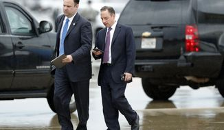 White House Director of Social Media Dan Scavino, left, walks with former White House Chief of Staff Reince Priebus steps off Air Force One as they arrive Friday, July 28, 2017, at Andrews Air Force Base, Md. Trump says Homeland Secretary Secretary John Kelly is his new White House chief of staff. (AP Photo/Alex Brandon)