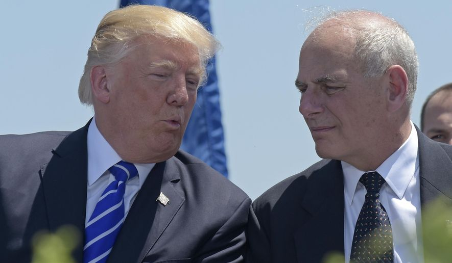 FILE - In this May 17, 2017, file photo, President Donald Trump talks with Homeland Security Secretary John Kelly during commencement exercises at the U.S. Coast Guard Academy in New London, Conn. Trump named Kelly as his new Chief of Staff on July 28, ousting Reince Priebus. (AP Photo/Susan Walsh)