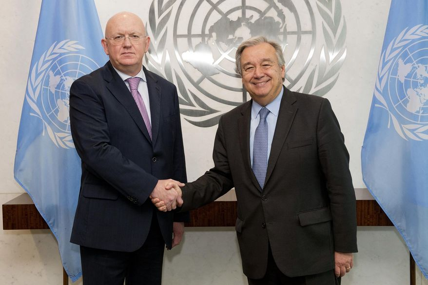 Russia's new ambassador to the United Nations Vassily Alekseevich Nebenzia, left, shakes hands with U.N. Secretary General Antonio Guterres when he presented his credentials, at United Nations headquarters, Friday, July 28, 2017.  (Eskinder Debebe/United Nations via AP)