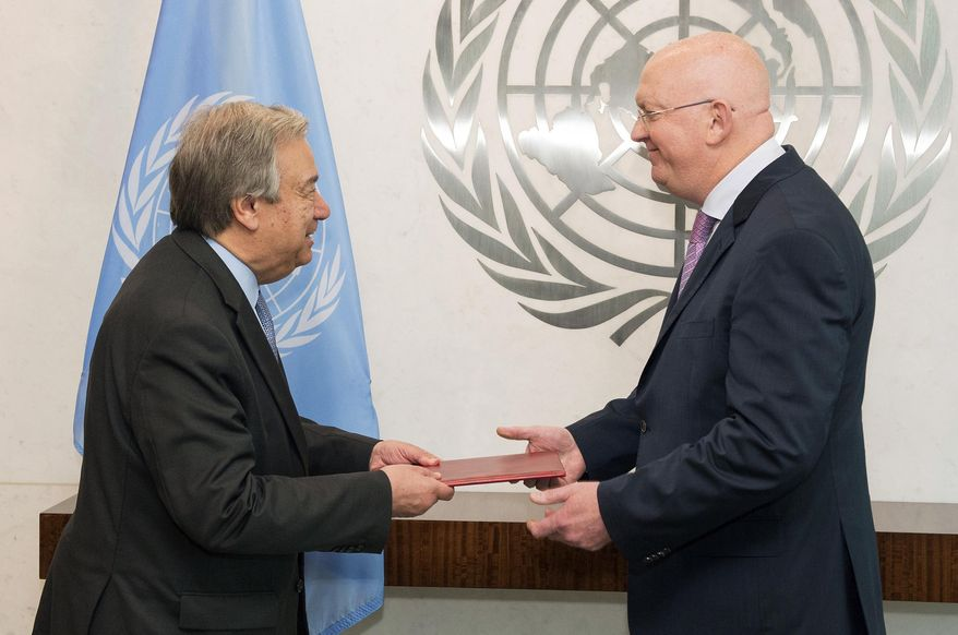 Russia's new ambassador to the United Nations Vassily Alekseevich Nebenzia, right, presents his credentials to U.N. Secretary General Antonio Guterres, at United Nations headquarters, Friday, July 28, 2017. (Eskinder Debebe/United Nations via AP)