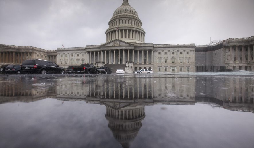 The Capitol is seen during a heavy rain in Washington, Friday, July 28, 2017. The White House and the Capitol sit two miles apart, but this week, they might as well have been two worlds away. Republicans labored over health care while White House officials labored to save their jobs amid a public - and sometimes shockingly vulgar - feud between senior staff. (AP Photo/J. Scott Applewhite)