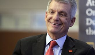 FILE - In this Friday, March 17, 2017, file photo, Wells Fargo CEO & President Timothy Sloan is interviewed in one of his bank's branches in New York. Scandal-plagued Wells Fargo is back in hot water for signing customers up for products that they didn't need or want. This time it's auto insurance, and the bank says it may have cost 20,000 people their cars. The San Francisco-based bank acknowledged late Thursday, July 28, 2017 that it enrolled roughly 570,000 auto loan borrowers for what's known as collateral production insurance on their vehicles when the customers already had appropriate insurance. (AP Photo/Richard Drew, File)