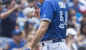 Toronto Blue Jays pitcher Roberto Osuna walks off the field after giving up three runs in a blown save and the win to the Los Angeles Angels in the ninth inning of their AL baseball game, in Toronto on Saturday July 29, 2017. (Fred Thornhill/The Canadian Press via AP)