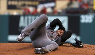Arizona Diamondbacks pitcher Robbie Ray writhes in pain Friday, July 28, 2017, after getting hit on the head by a ball hit by St. Louis Cardinals' Luke Voit during the second inning of a baseball game in St. Louis. Ray left the game. (Christian Gooden/St. Louis Post-Dispatch via AP)