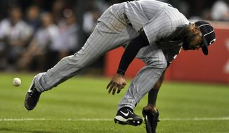 Cleveland Indians right fielder Austin Jackson misses an RBI-double by Chicago White Sox's Tim Anderson during the sixth inning of a baseball game Saturday, July 29, 2017, in Chicago. (AP Photo/Paul Beaty)
