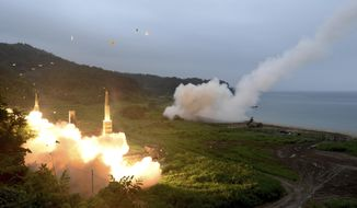 In this photo provided by South Korea Defense Ministry, South Korea's Hyunmoo II Missile system, left, and U.S. Army Tactical Missile System, right, fire missiles during the combined military exercise between the two countries against North Korea at an undisclosed location in South Korea, Saturday, July 29, 2017. North Korean leader Kim Jong Un said Saturday the second flight test of an intercontinental ballistic missile demonstrated his country can hit the U.S. mainland, hours after the launch left analysts concluding that a wide swath of the United States, including Los Angeles and Chicago, is now in range of North Korean weapons. (South Korea Defense Ministry via AP)