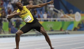 FILE - In this Aug. 18, 2016, file photo, Usain Bolt celebrates winning the gold medal in the men's 200-meter final during the athletics competitions of the 2016 Summer Olympics at the Olympic stadium in Rio de Janeiro, Brazil. The man who reshaped the record book and saved his sport along the way is saying goodbye. His runs through the 100 meters and Jamaica's 4x100 relay at next week's world championships are expected to produce golds yet again, along with leaving people to wonder who could possibly take his place. (AP Photo/David J. Phillip, File)