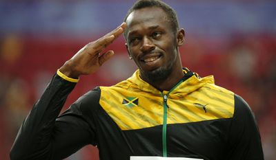 FILE - In this Aug. 12, 2013, file photo, Jamaica's Usain Bolt gestures on the podium before receiving his gold medal for the men's 100-meter at the World Athletics Championships in Moscow, Russia. The man who reshaped the record book and saved his sport along the way is saying goodbye. His runs through the 100 meters and Jamaica's 4x100 relay at next week's world championships are expected to produce golds yet again, along with leaving people to wonder who could possibly take his place. (AP Photo/Alexander Zemlianichenko, File)