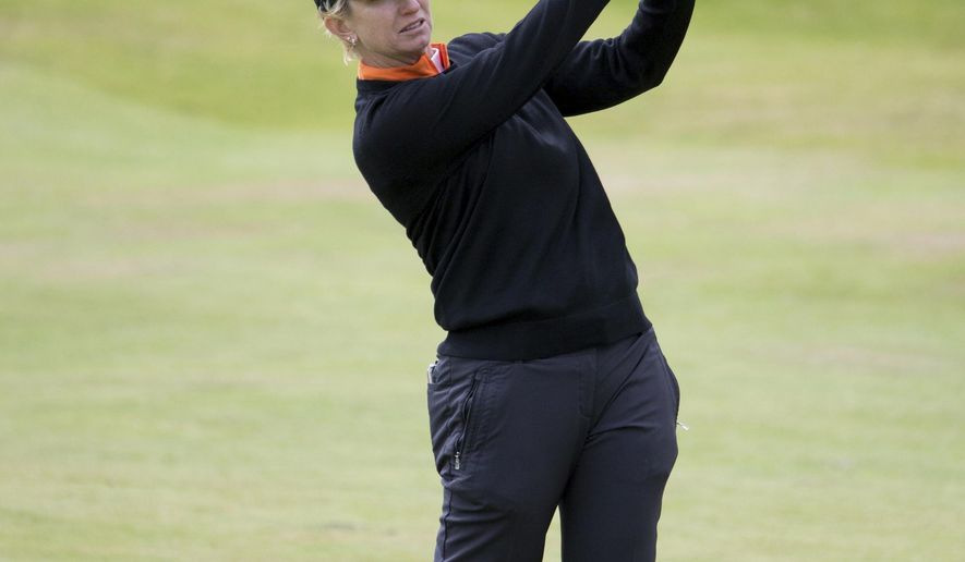 Australia's Karrie Webb plays her approach to the par 4 1st hole during  day three of the Ladies Scottish Open at Dundonald Links, North Ayrshire. Scotland, Saturday July 29, 2017. (Kenny Smith/PA via AP)