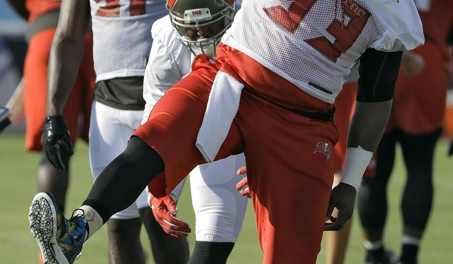 Tampa Bay Buccaneers defensive tackle Gerald McCoy (93) stretches during an NFL football training camp practice Saturday, July 29, 2017, in Tampa, Fla. (AP Photo/Chris O'Meara)