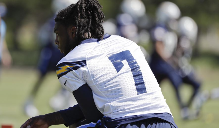 FILE - This MAY 23, 2017 photo shows San Diego Chargers rookie wide receiver Mike Williams looking on during an NFL football practice in San Diego. The Los Angeles Chargers placed Williams on the physically unable to perform list with a back injury Saturday, July 29, 2017. (AP Photo/Gregory Bull)