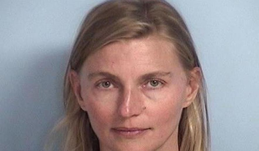 This photo provided by Walton County Sheriff's Office shows Terri White, the commissioner for the Oklahoma Department of Mental Health and Substance Abuse Services, who was jailed July 21, 2017, on a misdemeanor battery complaint after calling police in attempts to deescalate a family dispute. White was arrested in Florida after throwing a cup of water on a family member during a confrontation, but her case was dismissed because prosecutors said the family member decided not to pursue charges, the official said Saturday, July 29, 2017. (Walton County Sheriff's Office via AP)