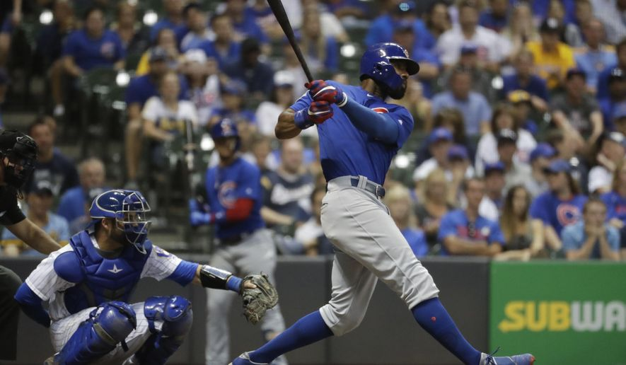 Chicago Cubs' Jason Heyward hits a home run during the 11th inning of a baseball game against the Milwaukee Brewers Saturday, July 29, 2017, in Milwaukee. (AP Photo/Morry Gash)