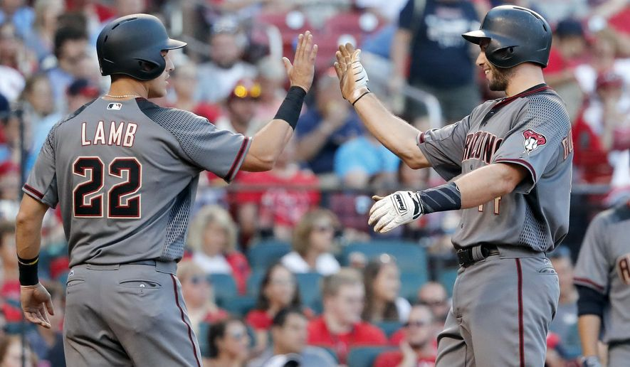 Arizona Diamondbacks' Paul Goldschmidt, right, is congratulated by teammate Jake Lamb (22) after hitting a two-run home run during the fourth inning of a baseball game against the St. Louis Cardinals, Saturday, July 29, 2017, in St. Louis. (AP Photo/Jeff Roberson)