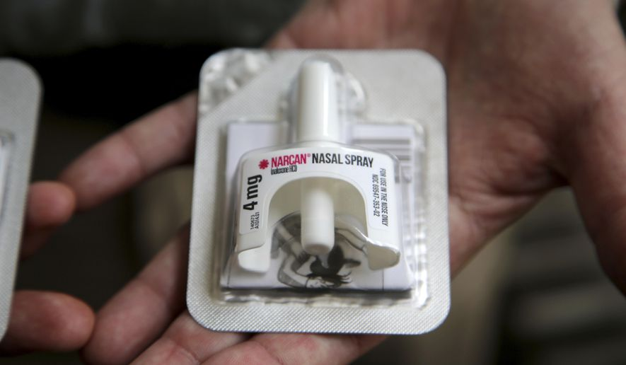In this June 14, 2017, photo, Cook County Sheriff Tom Dart shows Naloxone, an overdose-reveal nasal spray drug at the sheriff's office in Cook County Jail, the largest single site jail in the United States, has joined the growing number of jails to hand to inmates on their way out the door kits containing naloxone. (AP Photo/G-Jun Yam)