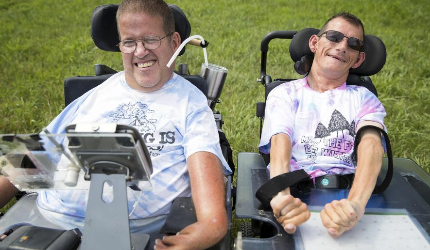 FOR RELEASE SATURDAY, JULY 29, 2017, AT 12:01 A.M. CDT.-Dave Walter, 54, left, who has attended Easter Seals Camp since he was 8 years old and Larry Wolfe, 45, who has attended camp since he was 10 years old, hang out at Easter Seals Camp Tuesday, July 11, 2017, in Cedar Bluffs, Neb. (Rebecca Gratz/The World-Herald via AP)