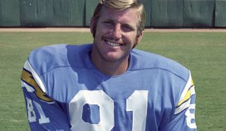 FILE - In this 1970 file photo, San Diego Chargers NFL football player Jeff Staggs poses in San Diego.  Staggs struggled with his memory before he died. His brain was donated to a Boston brain bank that studies chronic traumatic encephalopathy, or CTE. A study published this week found the disease in 110 of 111 brains from former NFL players. Staggs was one of them. (AP Photo/File)