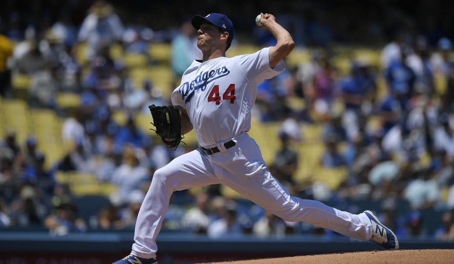 Los Angeles Dodgers starting pitcher Rich Hill throws to the plate during the first inning of a baseball game against the San Francisco Giants, Saturday, July 29, 2017, in Los Angeles. (AP Photo/Mark J. Terrill)