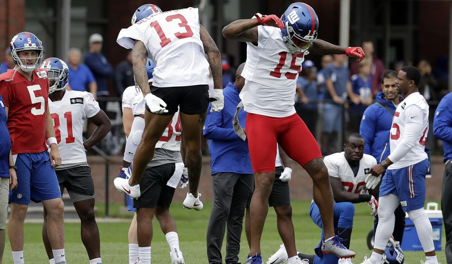New York Giants wide receiver Odell Beckham (13) and wide receiver Brandon Marshall (15) celebrate after Marshall made a catch during NFL football camp, Saturday, July 29, 2017, in East Rutherford, N.J. (AP Photo/Julio Cortez)