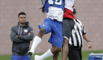 New York Giants cornerback Janoris Jenkins (20) intercepts a pass intended for wide receiver Sterling Shepard (87) during NFL football training camp, Saturday, July 29, 2017, in East Rutherford, N.J. (AP Photo/Julio Cortez)
