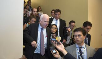 In this July 28, 2017, file photo, Sen. John McCain, R-Az., is pursued by reporters on Capitol Hill in Washington. (AP Photo/Cliff Owen, File)