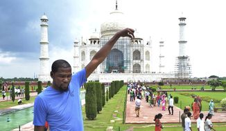NBA basketball player Kevin Durant poses in front of Taj Mahal in Agra, India, Saturday, July 29, 2017. Durant is in India to support the continued growth of basketball in the country and meet the elite prospects of NBA Academy India. (AP Photo/Pawan Sharma)