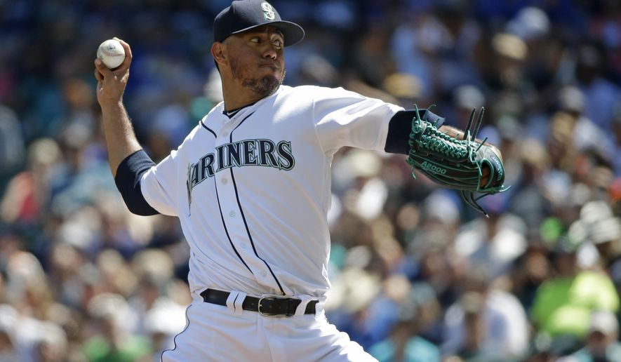 Seattle Mariners starting pitcher Yovani Gallardo throws against the New York Mets in the first inning of a baseball game, Saturday, July 29, 2017, in Seattle. (AP Photo/Ted S. Warren)