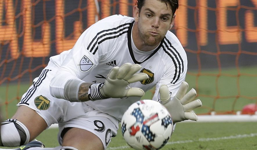 Portland Timbers goalkeeper Jake Gleeson makes a save against the Houston Dynamo in the first half of an MLS soccer game in Houston, Saturday, July 29, 2017. (Thomas B. Shea/Houston Chronicle via AP)