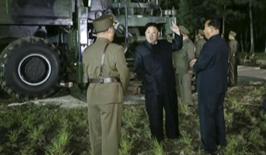 In this image made from video by North Korea's KRT on Friday, July 28, 2017, North Korean leader Kim Jung Un, center, gestures at the site of a missile test at an undisclosed location in North Korea. Kim said Saturday, July 29, 2017, the second flight test of an intercontinental ballistic missile demonstrated his country can hit the U.S. mainland, hours after the launch left analysts concluding that a wide swath of the United States, including Los Angeles and Chicago, is now in range of North Korean weapons. (KRT via AP Video)