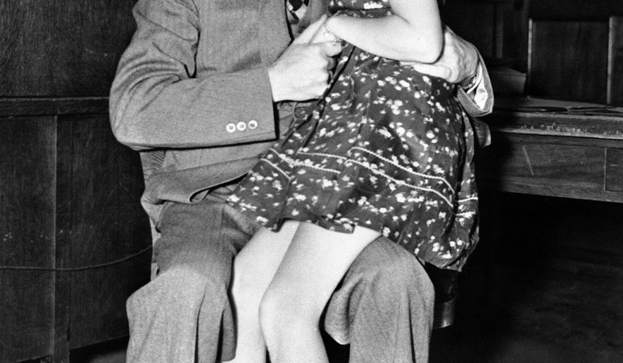 FILE - In this April 13, 1938, file photo, actor Stan Laurel hugs his daughter Lois in Los Angeles. Lois Laurel Hawes, the daughter of famed comedian Stan Laurel, has died. She was 89. A family statement says Hawes died late Friday, July 28, 2017 at a Los Angeles hospital after a long illness. Her mother was Laurel's first wife, Lois Neilson. (AP Photo, File)