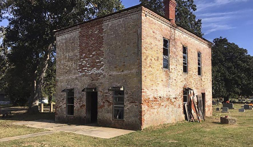 This photo provided by the Grant Preservation Board of Louisiana shows the Old Colfax Jail in Colfax, La., which was recently bought and donated to the nonprofit board. Board President Trevor Fry says the first concern is to secure its doors and windows, but the board wants to preserve one of the town's few remaining 19th century buildings for future generations. (Amber Davis/Grant Preservation Board of Louisiana via AP)