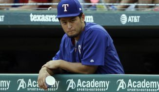 Texas Rangers' Yu Darvish, of Japan, leans on the dugout rail during the first inning of a baseball game against the Baltimore Orioles, Friday, July 28, 2017, in Arlington, Texas. (AP Photo/Tony Gutierrez)