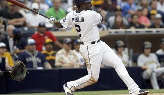 San Diego Padres' Jose Pirela watches a third-inning triple against the Pittsburgh Pirates, his second of the night, during the third inning of a baseball game in San Diego, Saturday, July 29, 2017. (AP Photo/Alex Gallardo)
