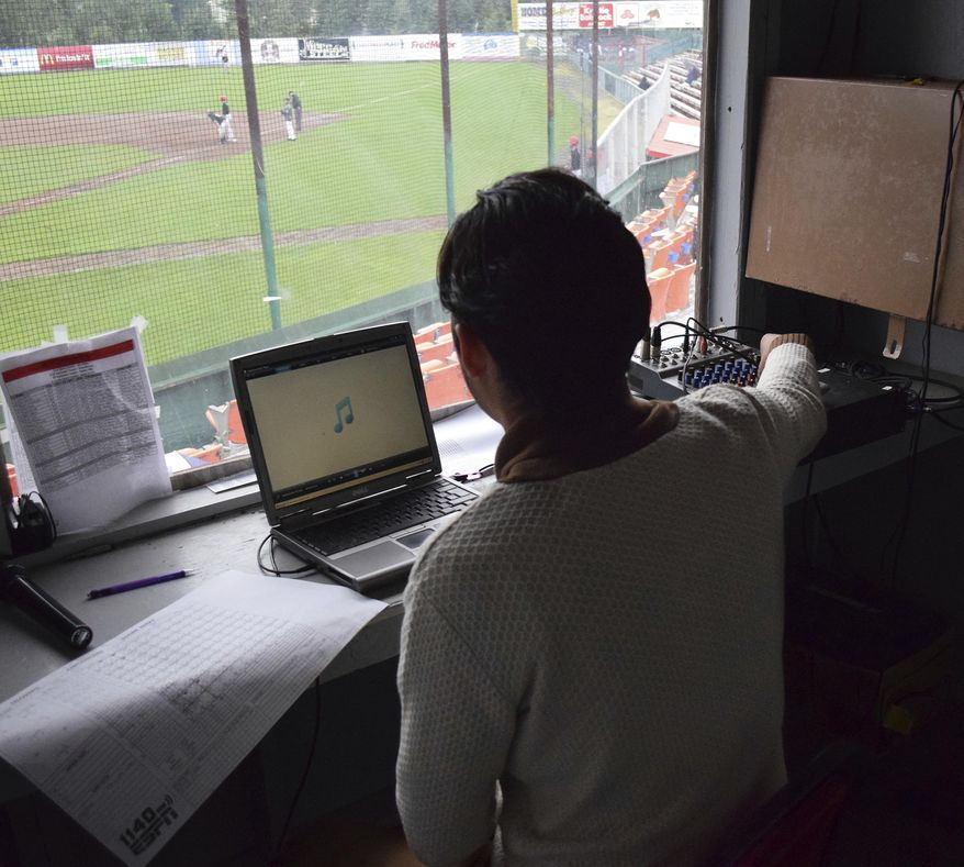 Peninsula Oilers public announcer Casey Roehl works the sound system at Coral Seymour Memorial Ballpark during a Wednesday, July 19, 2017 Alaska Baseball League contest against the Anchorage Bucs in Kenai, Alaska. Roehl's rapid rise to his current position behind the mic and soundboard at Coral Seymour Memorial Park in Kenai has been nothing less than remarkable. (Joey Clecka/Peninsula Clarion via AP)