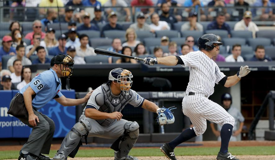 New York Yankees' Brett Gardner connects for a base hit allowing Jacoby Ellsbury to score the winning run against the Tampa Bay Rays during the ninth inning of a baseball game, Saturday, July 29, 2017, in New York. The Yankees won 5-4. (AP Photo/Julie Jacobson)