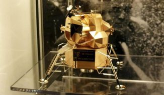 This image provided by Armstrong Air and Space Museum shows a  lunar module replica at Armstrong Air and Space Museum in Wapakoneta, Ohio. Police say the rare gold replica of the lunar space module has been stolen from the museum.Police responded to an alarm at the museum just before midnight Friday, July 28, 2017, and discovered the 5-inch high, solid-gold replica had been stolen.  (Armstrong Air and Space Museum/Wapakoneta police department via AP)