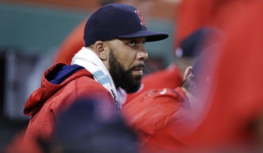 Boston Red Sox starting pitcher David Price sits in the dugout in the seventh inning during a baseball game against the Kansas City Royals at Fenway Park, Friday, July 28, 2017, in Boston. The Red Sox announced that Price was added to the 10-day disabled list prior to the game. (AP Photo/Charles Krupa)