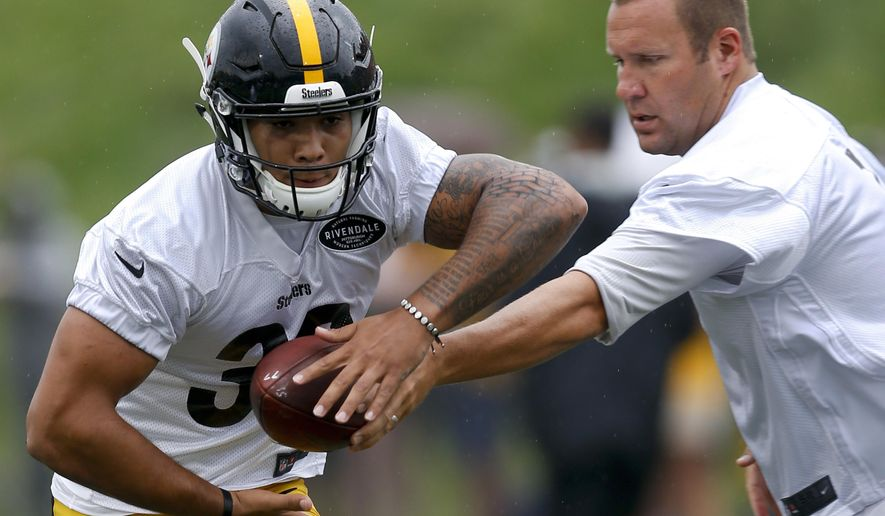 Pittsburgh Steelers quarterback Ben Roethlisberger, right, hands off to running back James Conner during practice at NFL football training camp at Latrobe High School in Latrobe, Pa., Friday, July 28, 2017 . (AP Photo/Keith Srakocic)